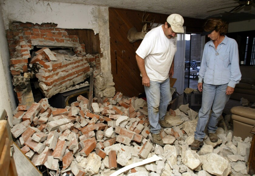 A couple survey the damage to their Parkfield home after a magnitude 6 earthquake hit southern Monterey County in 2004.