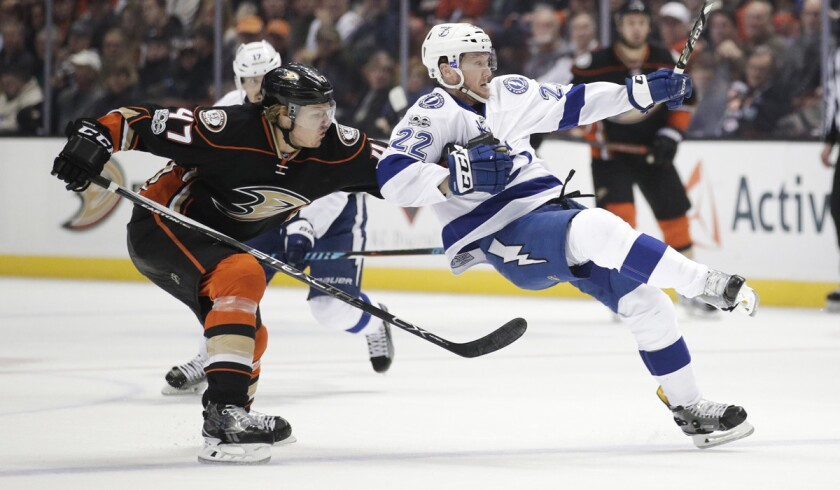 The Tampa Bay Lightning's Erik Condra, right, is the pulled by Ducks' Hampus Lindholm during a Jan. 17 game at Honda Center.