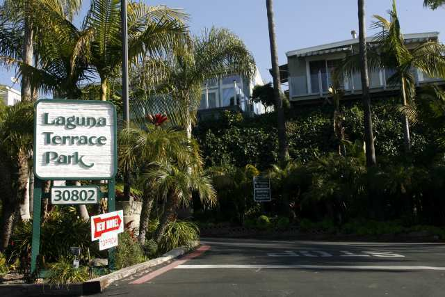 Son arrested after mother's death in Laguna Beach had blood on his clothes, officials say