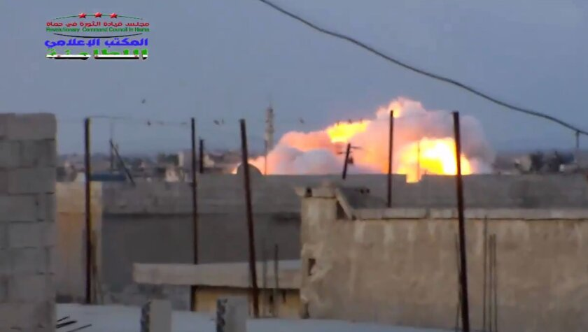This image provided by the Syrian Revolutionary Command Council in Hama shows smoke rising after a Russian airstrike in the town of Latamna near Hama on Oct. 7, 2015.