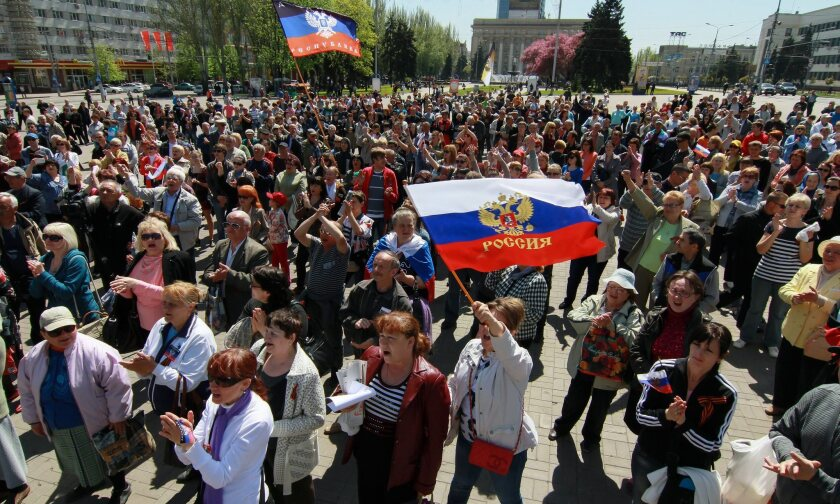 Separatist movements in eastern Ukraine that the West believes are instigated by Moscow have brought sanctions down on the Russian economy. At a Sunday rally in Donetsk, above, hundreds marched in demand of independence from Kiev.
