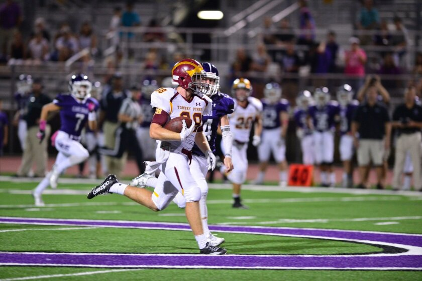 Caden Kelley to Michael Gadinas (88) for 60 yards. Photo by Anna Scipione