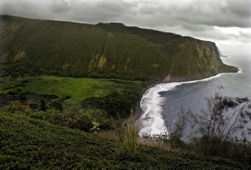Bicycle Adventures' family bike tour of the Big Island includes a stop at lush Waipio Valley, shown above in a file photo.