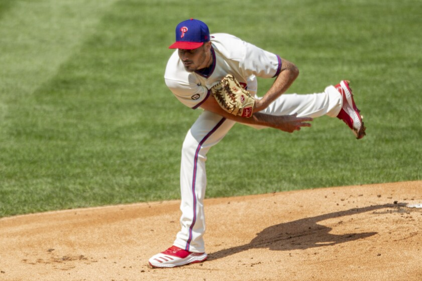 Philadelphia Phillies starting pitcher Zach Eflin throws during the first inning of a baseball game against the Atlanta Braves, Sunday, April 4, 2021, in Philadelphia. (AP Photo/Laurence Kesterson)