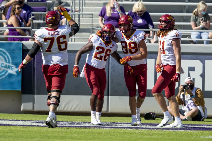 Iowa State running back Breece Hall (28) is congratulated by teammates after scoring a touchdown during an NCAA college football game against TCU on Saturday, Sept. 26, 2020 in Fort Worth, Texas. Iowa won 37-34. (AP Photo/Brandon Wade)