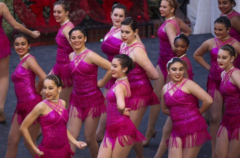 A dance group with the San Diego Dance Arts performs during December Nights at Balboa Park in San Diego on Saturday.