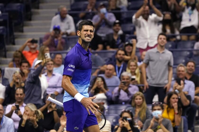 Novak Djokovic reacts after scoring a point against Matteo Berrettini.