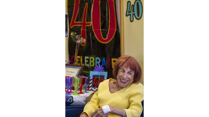 Celia Kanter, 77, smiles during a party Friday at Newport Beach Dialysis in honor of her 40 years on the kidney treatment.