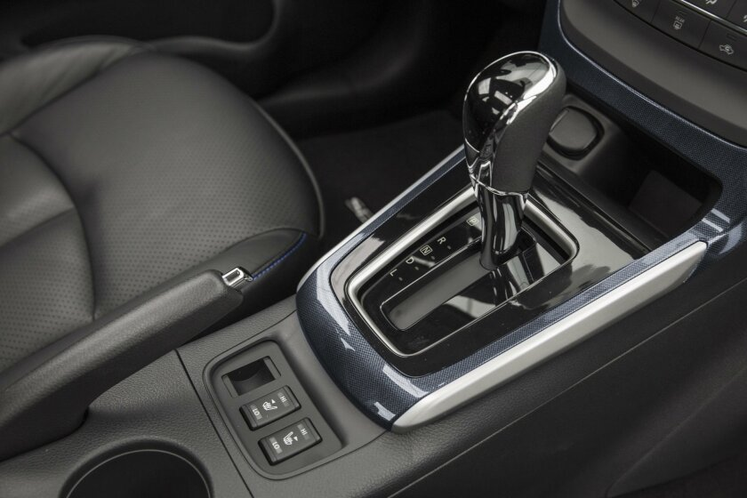 There are many considerate features for the daily drive, such as nicely padded armrests and a small e-bin charging area just ahead of the shift console.