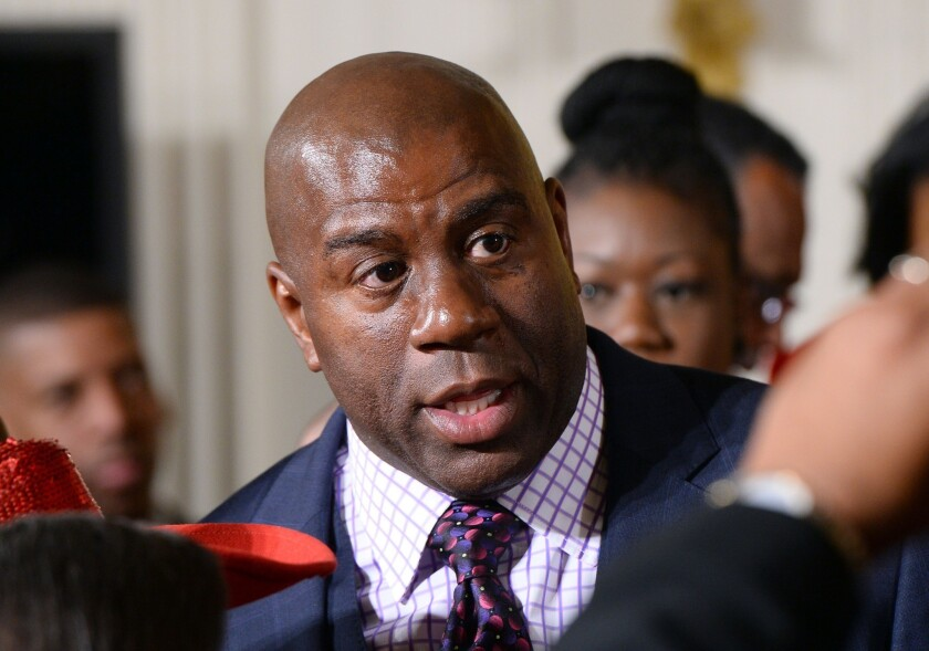 Magic Johnson attends an event at the White House on Feb. 27, 2014.