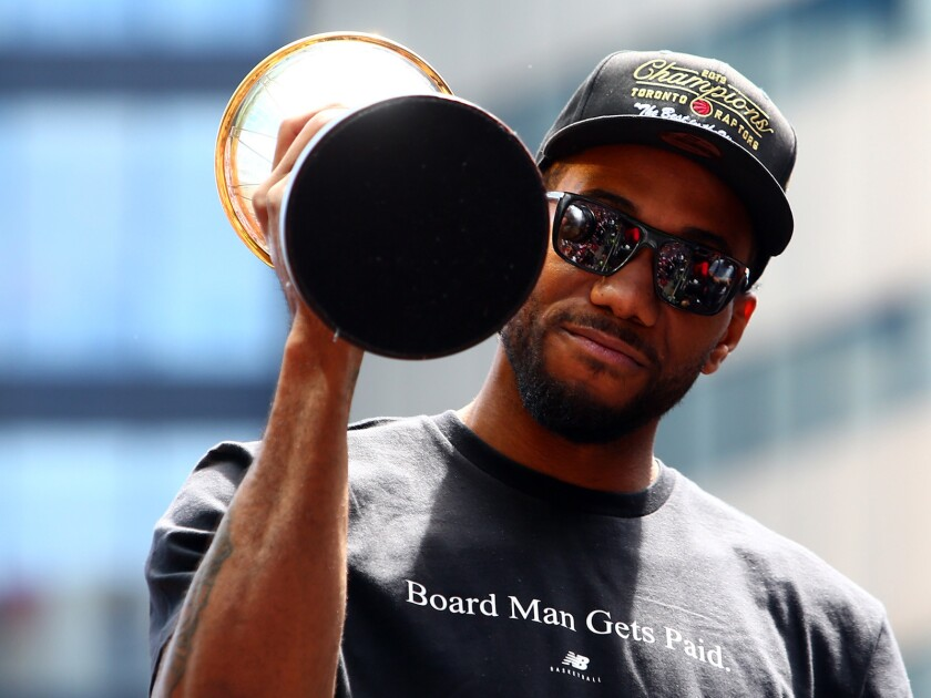 Kawhi Leonard holds the NBA Finals MVP trophy during the Raptors' victory parade on June 17, 2019, in Toronto.