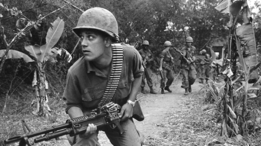 A paratrooper of the U.S. 82nd Airborne Brigade advances near Hue, South Vietnam on April 3, 1968.