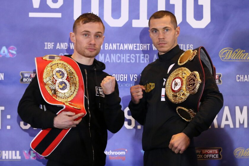 In this photo taken on Thursday, Feb. 25, 2016, Carl Frampton, left, and Scott Quigg pose at a press conference in Manchester, England. With British fighters holding 13 versions of world titles, the country's boxing scene is booming and two of those champions face off on Saturday, Feb. 27. 2016, in a matchup that has been in the making for years. Scott Quigg and Carl Frampton, unbeaten boxers holding the WBA and IBF belts respectively, fight in Manchester to unify super-bantamweight titles. It's only the third all-British unification fight in the last 23 years. (Simon Cooper/PA via AP) UNITED KINGDOM OUT - NO SALES - NO ARCHIVES