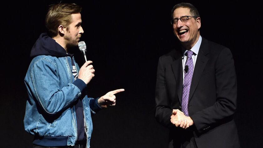 "Ryan Gosling, left, interacts with Chairman of Sony Pictures Entertainment Tom Rothman onstage at the CinemaCon 2017 opening-night presentation of upcoming Sony Pictures, including ""Blade Runner 2049,"" starring Gosling."
