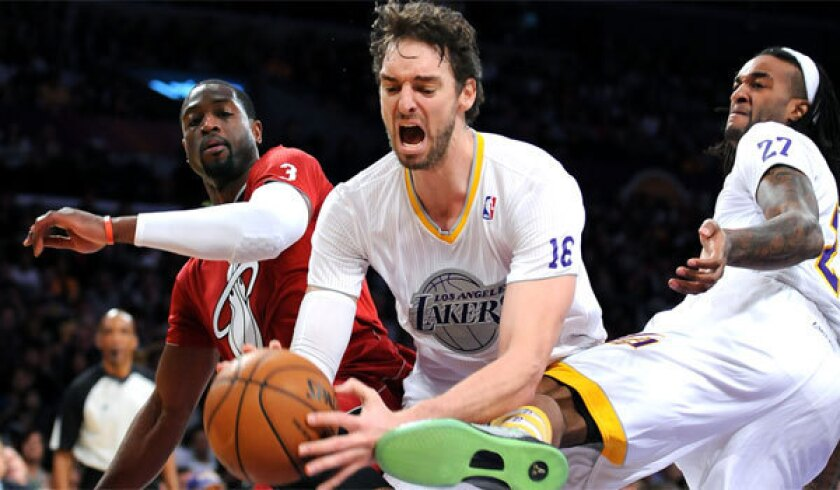 Pau Gasol is fouled by Miami's Dwayne Wade, left, as Jordan Hill (27) falls away at Staples Center on Wednesday.