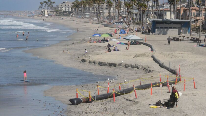 Sand dredged from the Oceanside harbor is used to replenish the city's beaches.