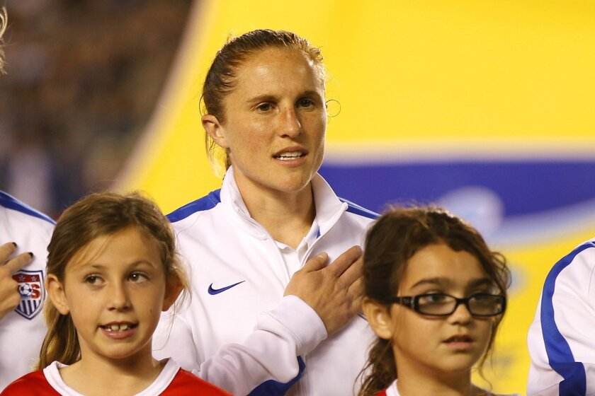 Rachel Van Hollebeke listens to the national anthem before a match against China at Qualcomm Stadium.