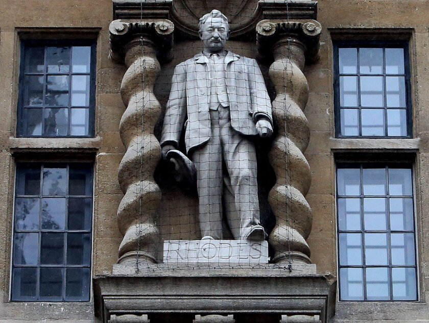 """The statue of Cecil Rhodes, on the front of Oriel College in Oxford England Friday Jan. 29, 2016. Oriel College said it will not remove a statue of 19th-century politician Cecil Rhodes that has sparked protests from students who call it an emblem of imperialism and racism. The governing body of Oriel College said that after """"careful consideration"""" it had decided to keep the statue, but would add """"a clear historical context to explain why it is there. (Steve Parsons/PA via AP) UNITED KINGDOM OUT"""