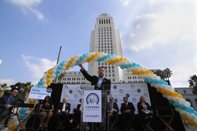 Peter Lee, head of California's ACA exchange, speaking in front of Los Angeles City Hall in November as the exchange launched its second year of enrollment.