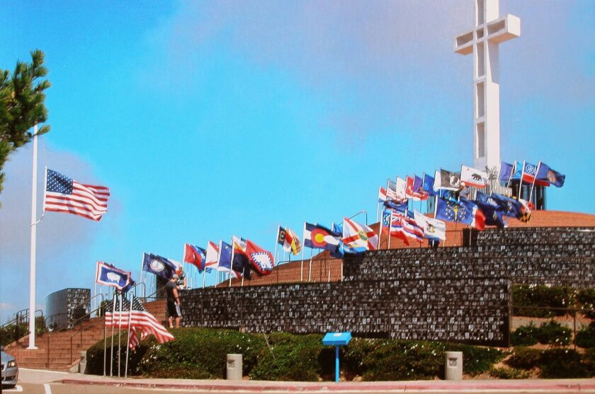 """Among the Veteran's Day events around San Diego County is a ceremony noon to 1 p.m. Nov. 8 at the Veteran's Memorial at Mt. Soledad, shown here. The photo is by Oceanside resident Albert Kapitanski, whose father, the late Alex Kapitanski was known as """"The Flagman."""" The Flagman gave out an estimated 3.5 million American flags during his lifetime at more than 37,000 ceremonial events, including at Mt. Soledad. Visit theflagman.org"""