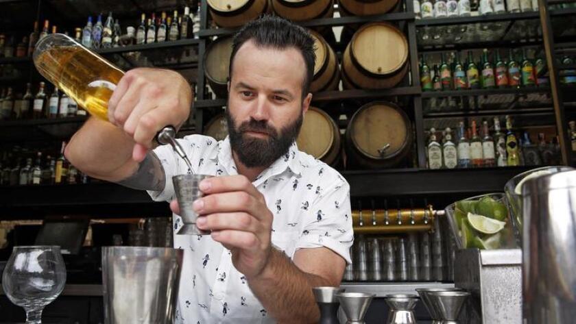 Steven Tuttle, SDCM Beverage Director, mixes up cocktails at Kettner Exchange. (Nancee E. Lewis)
