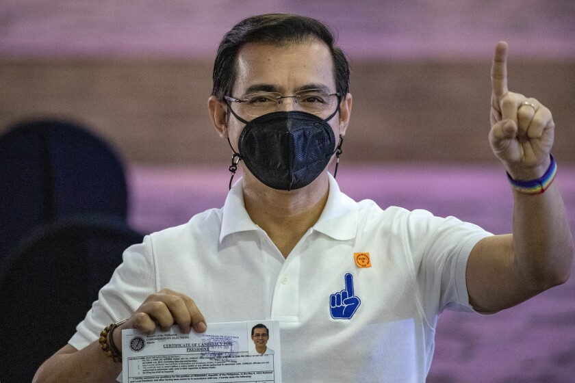 Manila City Mayor Isko Moreno gestures after filing his certificate of candidacy for next year's presidential elections before the Commission on Elections at the Sofitel Harbor Garden Tent in Metropolitan Manila, Philippines on Monday Oct. 4, 2021. Politicians continue to register as candidates seeking to lead the Southeast Asian nation that has been hit hard by the pandemic and deep political conflicts. (Ezra Acayan/Pool Photo via AP)