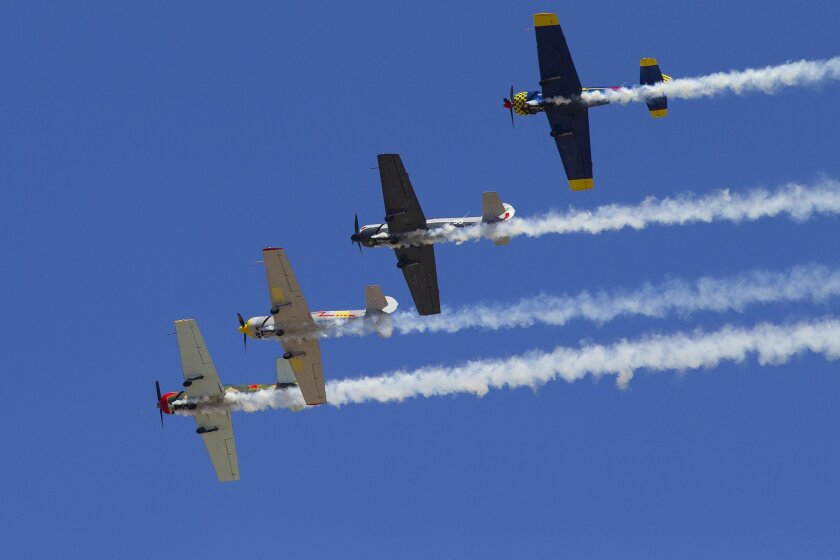 The Red Eagles Formation team flies overhead with smoke on for AirShow San Diego held in El Cajon at Gillespie Field.
