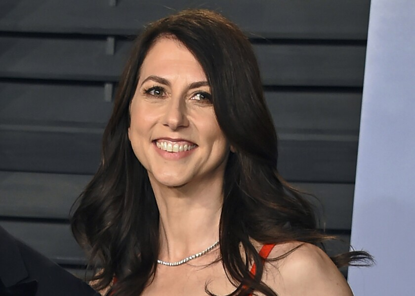 FILE - In this March 4, 2018, file photo, MacKenzie Bezos arrives at the Vanity Fair Oscar Party in Beverly Hills, Calif. Philanthropist MacKenzie Scott has funded organizations that received the most money for racial equity in 27 different states following the police killing of George Floyd. According to an AP analysis of new preliminary data from the philanthropy research organization Candid, Scott was responsible for approximately $567 million given to these organizations. (Photo by Evan Agostini/Invision/AP, File)