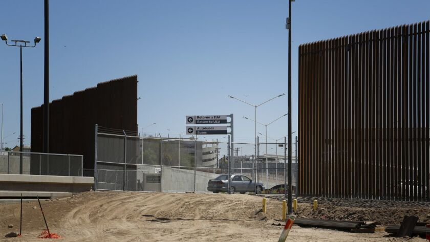 Border fencing is replaced along the Calexico-Mexicali line near the port of entry.