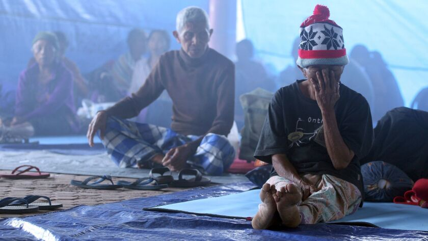 Villagers sit in a temporary shelter in Bali, Indonesia, on Sept. 23, 2017.