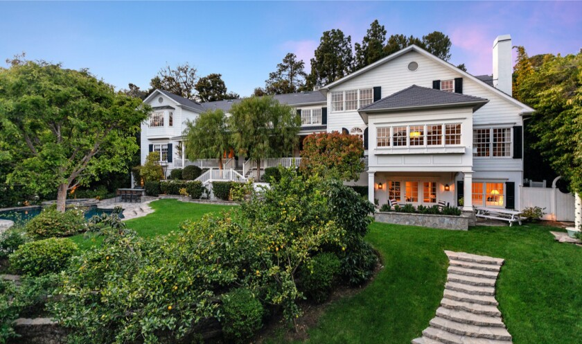 Built in 1999, the East Coast-inspired traditional sits on half an acre in gated Hidden Valley.