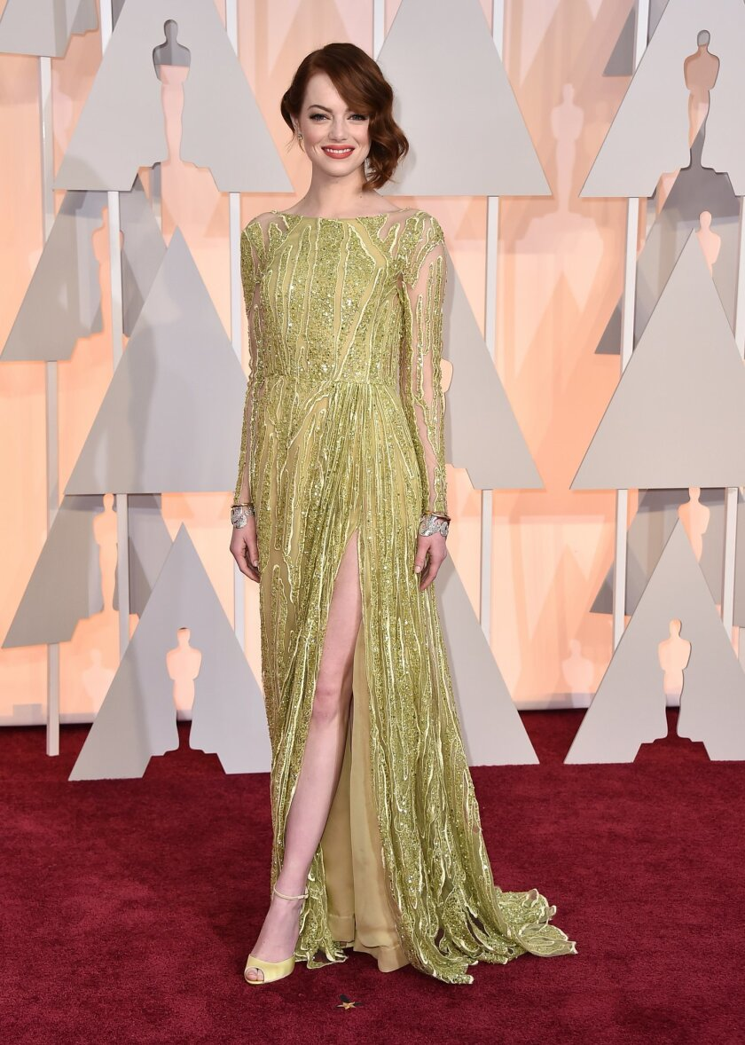 Emma Stone arrives at the Oscars on Sunday, Feb. 22, 2015, at the Dolby Theatre in Los Angeles. (Photo by Jordan Strauss/Invision/AP)