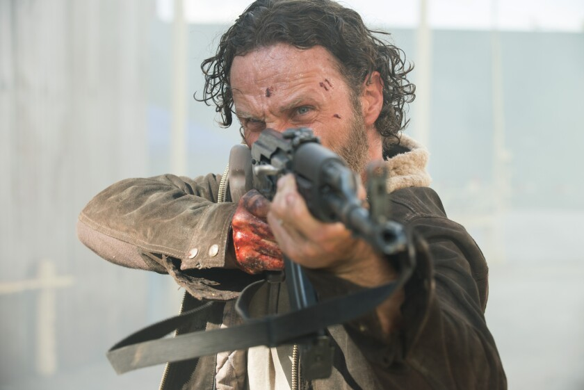"""Andrew Lincoln as Rick Grimes in an episode from """"The Walking Dead."""" The zombie drama is breaking more ratings records with its Season 5 premiere."""