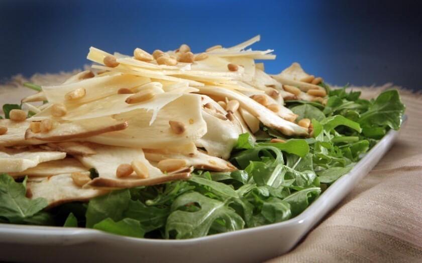 King trumpet mushroom salad with arugula and shaved Parmigiano.