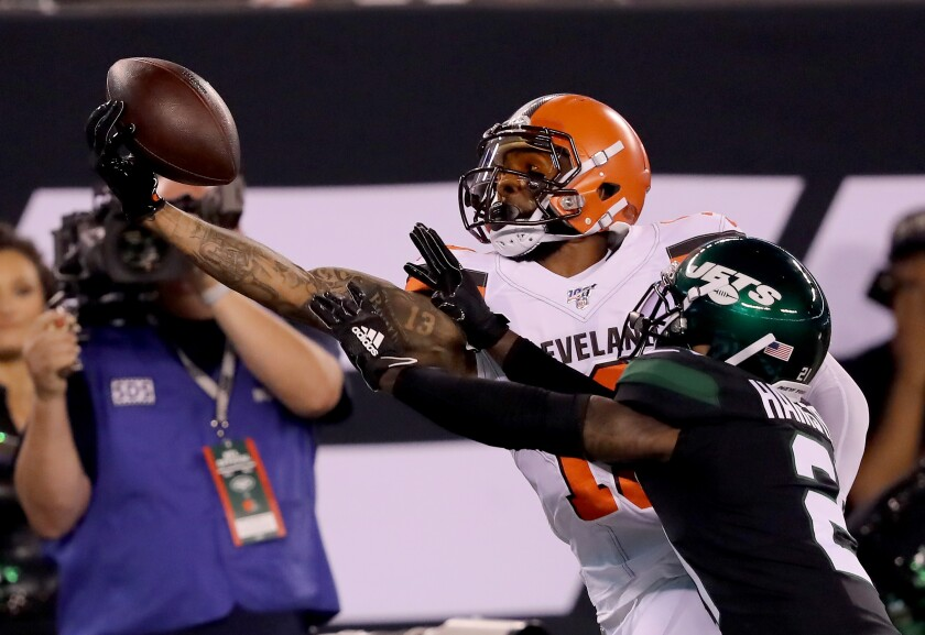 Cleveland Browns wide receiver Odell Beckham Jr. makes a catch over New York Jets cornerback Nate Hairston during Monday's game.
