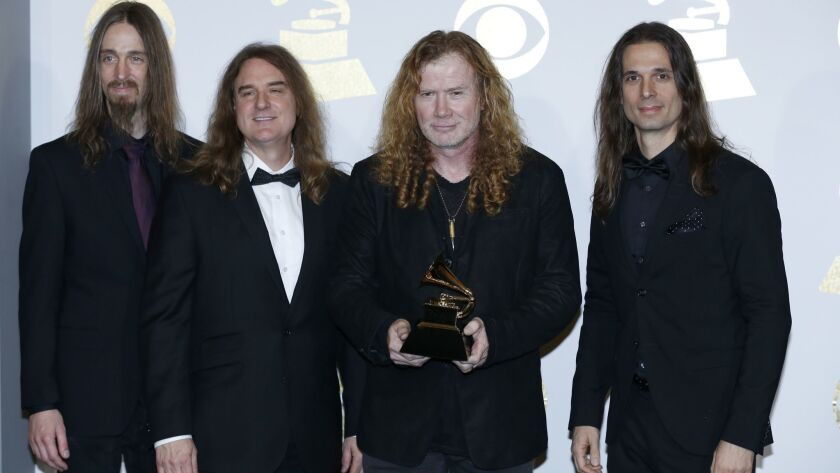 Dave Mustaine, second from right, displaying Megadeth's first Grammy at the 2017 awards ceremony.