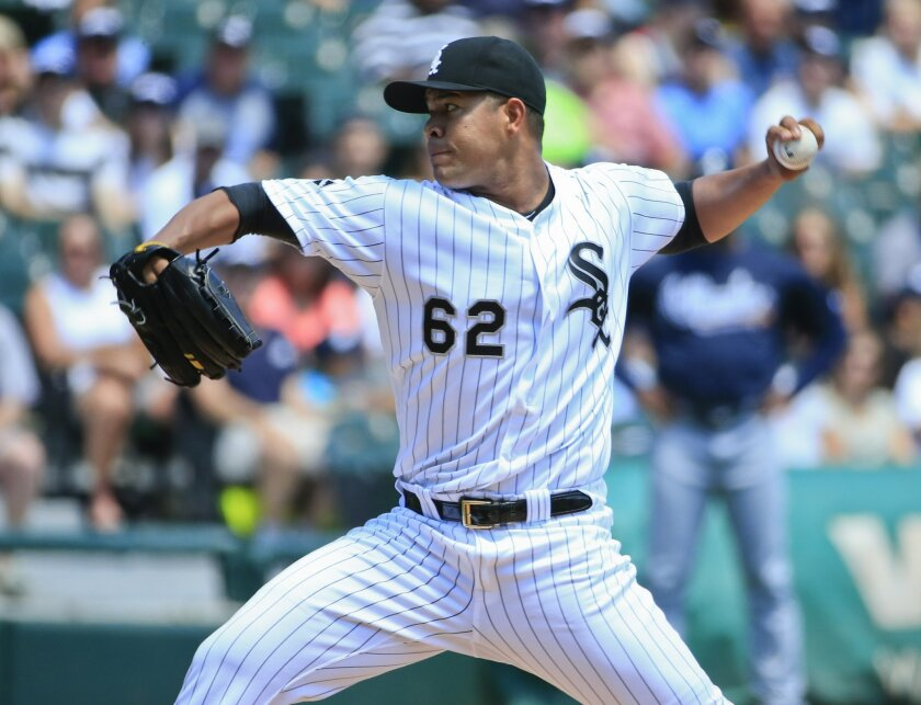 Chicago White Sox starter Jose Quintana delivers a pitch during the first inning of a baseball game against the Atlanta Braves, Saturday, July 9, 2016, in Chicago. (AP Photo/Kamil Krzaczynski)