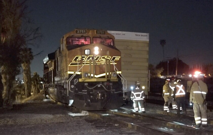 Investigators examine the scene of the deadly train collision in La Mirada.