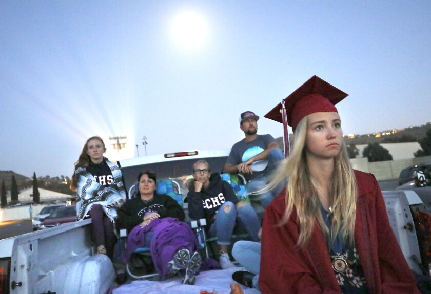 Steele Canyon High senior Kailey Deegan watches graduation video at the Santee Drive-In