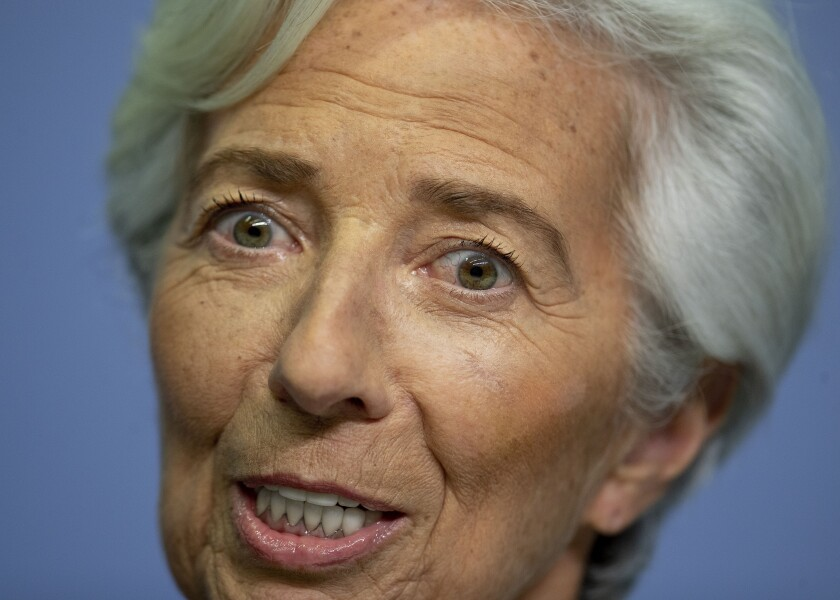 FILE - In this Jan.23, 2020 file photo President of European Central Bank Christine Lagarde smiles prior to a press conference following a meeting of the governing council in Frankfurt, Germany. (AP Photo/Michael Probst, file)