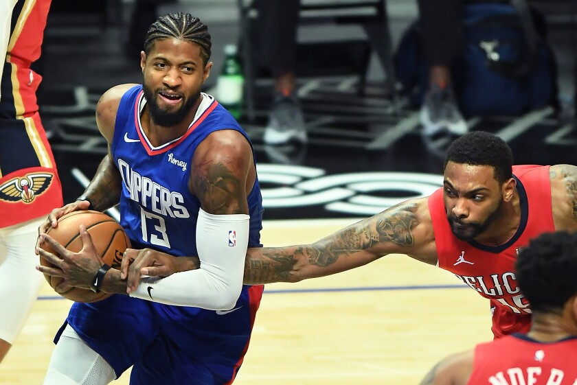 Clippers' Paul George is fouled by New Orleans Pelicans' Sindarius Thornwell.