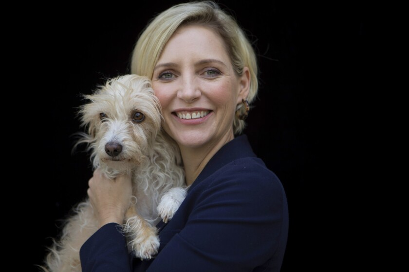 """The dog stays in the picture: """"Boundaries"""" director Shana Feste with Loretta, who is not only her pet but a featured canine in the film."""