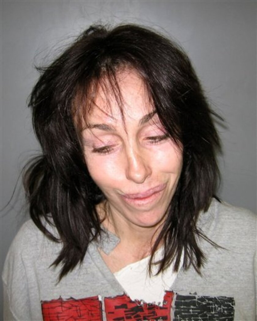 FILE - In this Feb. 7, 2008 file photo released by the Nye County Sheriff's Office, former Hollywood madam Heidi Fleiss is shown in a booking mug released in Pahrump, Nev. after she was arrested on charges of illegal possession of prescription drugs and driving under the influence. Fleiss has pleaded guilty to felony drug charges in Nevada, but will avoid a return trip to prison. (AP Photo/via Nye County Sheriff's Office (AP Photo/Nye County Sheriff's Office, File)