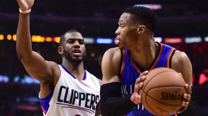 Clippers guard Chris Paul defends Oklahoma City Thunder guard Russell Westbrook on Monday night at Staples Center. Paul would leave the game after his thumb was injured in a collision involving Westbrook.