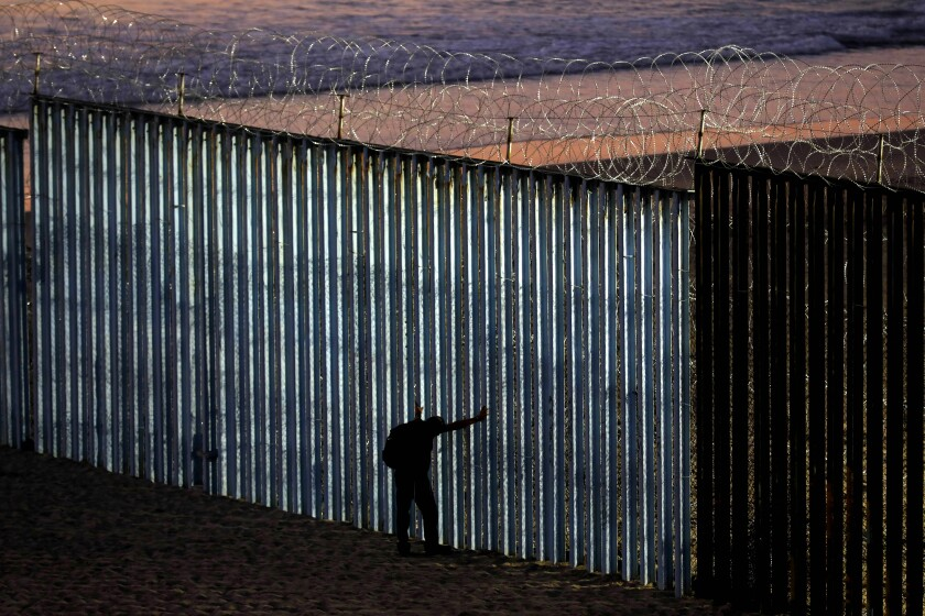 TIJUANA, BAJA CALIF. -- TUESDAY, NOVEMBER 20, 2018: The border wall is fortified with concertina wire at Playas Tijuana along the U.S. - Mexico border in Tijuana, Baja Calif., on Nov. 20, 2018. U.S. Customs and Border Protection hardened the wall with barbed wire in preparation for an increase of more people arriving with the migrant caravan. (Gary Coronado / Los Angeles Times)