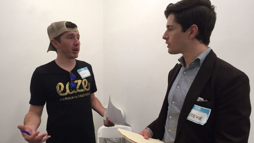Drew Rothe, left, who is recruiting drivers for the cannabis delivery service Eaze, chats with Stevie Ray-Vance, who recently moved to L.A. from Denver, and is looking to break into the cannabis industry