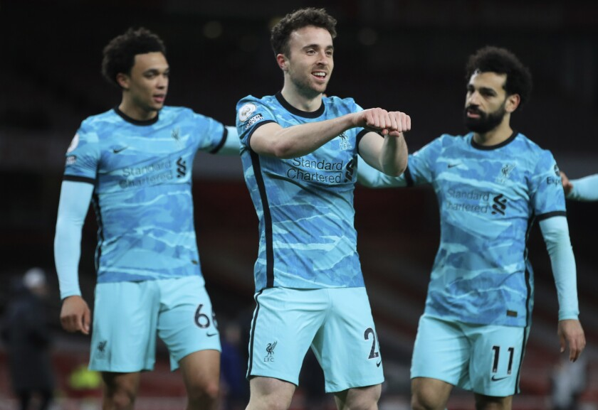 Liverpool's Diogo Jota, center, celebrates with teammates after scoring his sides first goal during the English Premier League soccer match between Arsenal and Liverpool at the Emirates Stadium in London, England, Saturday, April 3, 2021. (Adam Davy/Pool via AP)