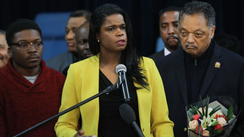 Cook County State's Atty. Kim Foxx, center, joined by Jesse Jackson Sr. and other supporters at a news conference.
