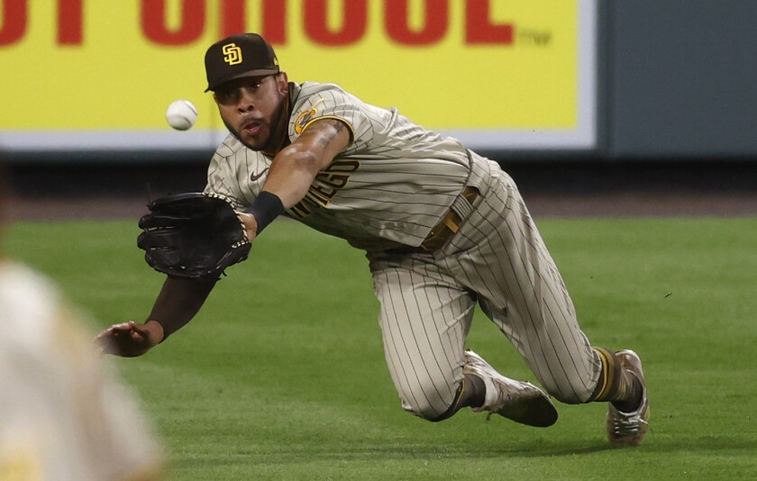 Padres left fielder Tommy Pham dives for a catch during 2020 season.