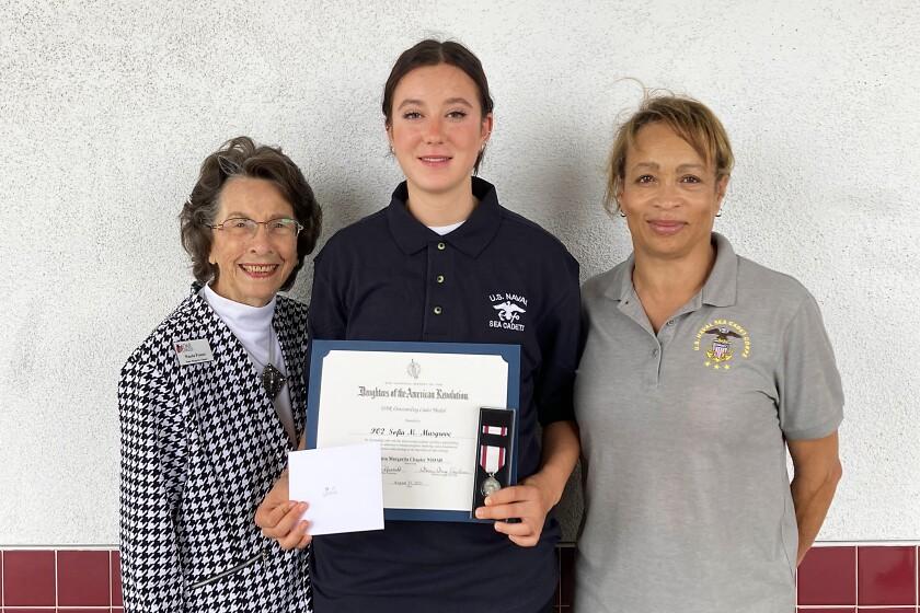 Santa Margarita Chapter DAR member Wanda Prosser, Petty Officer 2nd Class Sofia Musgrove, Lt. Cmdr. Valencia Jones